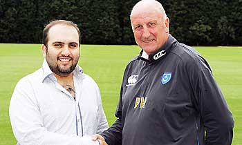 Sulaiman Al-Fahim with Paul Hart, who has accepted a two-year contract as Portsmouth manager. Photograph: Joe Pepler/Getty Images