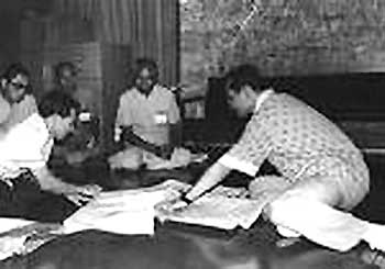HMK  (right) studies maps of Bangkok with BMA officials during 1983 heavy Flooding in Bangkok